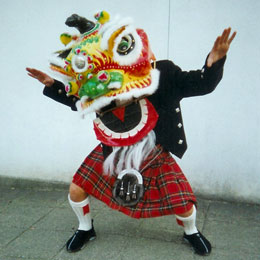 A man dressed in a kilt and dragon head costume for gung haggis fat choy celebration. Licensed by Roland Tanglao.