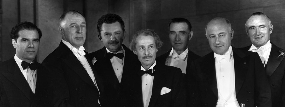 Special Award recipient D.W. Griffith, second from left, with, from left: Frank Capra, Griffith, Jean Hersholt, Henry B. Walthall, Frank Lloyd, Cecil B. DeMille, and Donald Crisp.