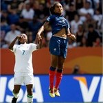 Stella Mbachu of Nigeria and Laures Georges of France battle for the ball