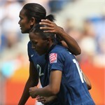 Marie-Laure Delie of France (R) celebrates the first goal with Wendie Renard
