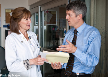 CTSI Director S. Claiborne Johnston talks with a colleague at UCSF