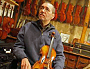 Clifford Roberts, a violin maker, had to retire from making violins because of a neromuscular atrophy disease. (Michael S. Wirtz / Inquirer).