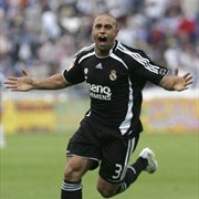 Roberto Carlos celebrates after scoring for Real Madrid