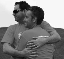 Two gay men hugging