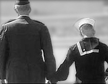 Two men in the military holding hands