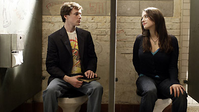 The high school's principal's daughter (Kat Dennings) seeks counsel in Charlie's stall/office. (MGM)