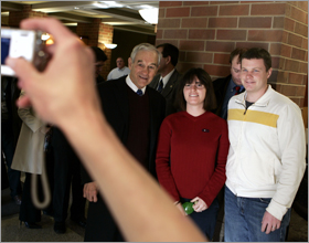 Republican presidential hopeful Representative Ron Paul of Texas poses for a photo during a campaign stop in Iowa
