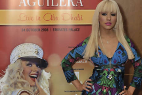 Christina Aguilera arrives at the Emirates Palace Hotel in Abu Dhabi, for a press conference before her concert.