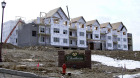 In this photo made Feb. 17, 2011, construction continues on a row of condominiums in Cranberry, Pa., Butler County.