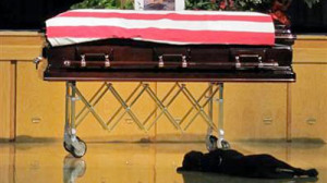 Loyal Dog Mourns at Casket of Fallen Navy SEAL