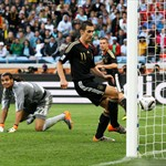 Miroslav Klose of Germany scores his team's second goal past Sergio Romero of Argentina