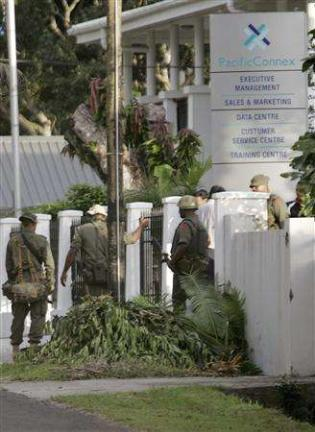 Fijian soldiers enter the offices of Pacific...