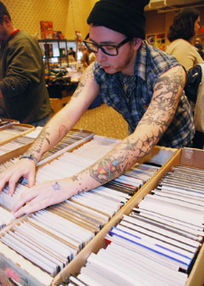 Dan Wars, 27, of Jamaica Plain looks through a box of comics at the Boston comic convention, held yesterday.