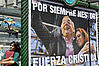 "A woman passes next to a poster which reads ""Nestor for ever"" and ""Cristina be strong"" in the surroundings of the Casa Rosada presidential palace in Buenos Aires."