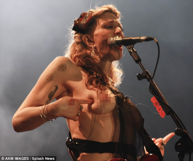Courtney Love strips down during her performance at a music festival in Sao Paulo Brazil