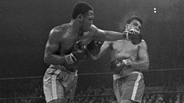 In this March 8, 1971, file photo, Joe Frazier lands a left on Muhammad Ali during the 15th round of their heavyweight title boxing bout in New York. Frazier won a unanimous decision. (Associated Press)