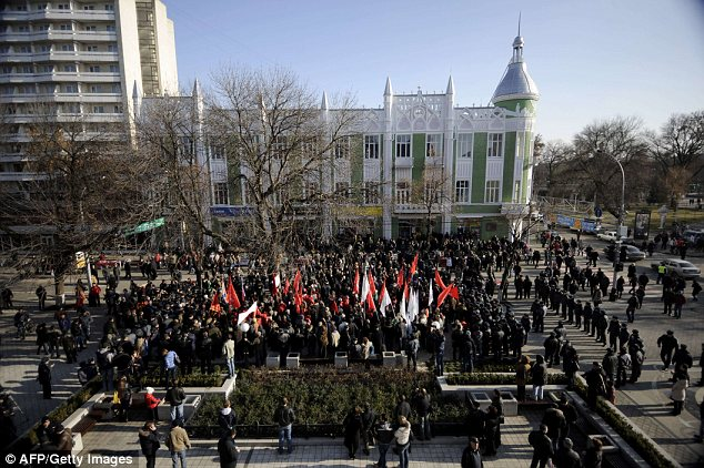 Overthrow: Opposition protesters in the southern Russian city of Krasnodar took to the streets today