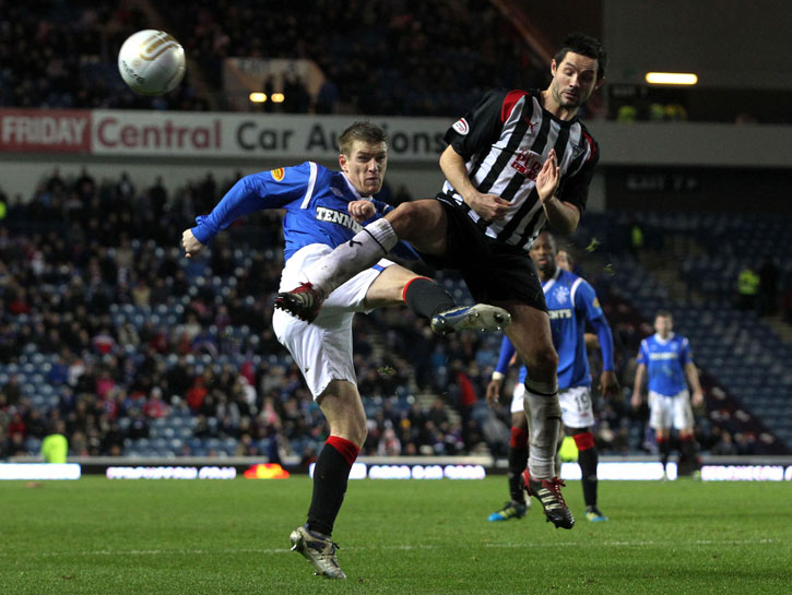 Steven Davis challenges for the ball...