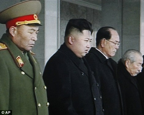 Remembering: In this image from KRT video, North Korea's next leader Kim Jong Un, 2nd left, and ceremonial head of state Kim Yong Nam, center, bow their heads at the memorial service