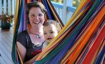 Marion Woodhead with her daughter Mya Burton-Woodhead relax in the hammock at their family.