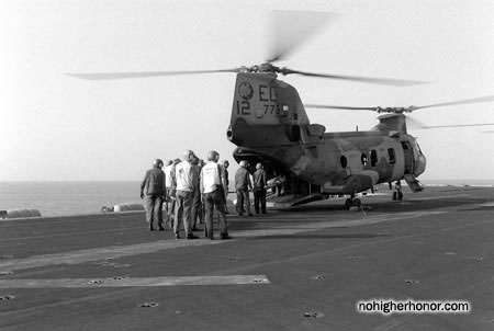 Sailors aboard <i>Raleigh</i> escort Iranian detainees to a CH-46 Sea Knight helicopter. The Iranians were captured during Operation Prime Chance, a part of the U.S. Navy's Operation Earnest Will.