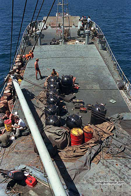 M-08 contact mines partially covered by a tarpaulin on the deck of the Iran Ajr, which was captured during Operation Prime Chance, a part of the U.S. Navy's Operation Earnest Will.