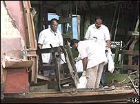 Forensic scientists collect samples from one of the bombed carriages