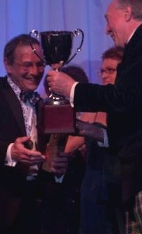 Peter Taylor OBE Chairman of The Town House Collection receives the 2010 Scottish Hotel of the Year winner's silver cup