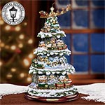Thomas Kinkade Wonderland Express Animated Tabletop Christmas Tree With Train - Exclusive Thomas Kinkade Animated Tabletop Christmas Tree with Music and Light! Rotating Santa Sleigh and Moving Trains!