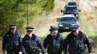 OPP officers are seen leaving the site where Tori Stafford's body was found near Mount Forest, Ont. Monday, April 2/2012. The jury in the Michael Rafferty trial were given a tour of the site after which the media were allowed to have access.