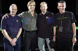 (From left to right) Chris Stamper, co-founder of Rare; Ed Fries, vice president of Xbox Game Content for Microsoft; Tim Stamper, co-founder of Rare; and Sandy Duncan, European vice president of Xbox, celebrate the $375 million Microsoft acquisition of Rare at Microsofts annual European games event, X02, in Seville, Spain.