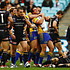 Massacre... the Eels celebrate another try over the hapless Tigers.