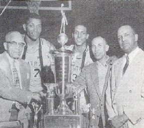 Fay Young of the Chicago Defender presents the NIIBT 1956 championship trophy to the Louisville Central team.