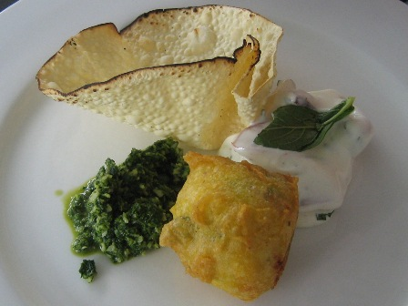 potato vada with mint chutney, tomato raita and flame toasted pappadam: