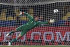 Denmark's goalkeeper Thomas Sorensen fails to save a second goal from a free kick by Japan's Yasuhito Endo during their 2010 World Cup Group E soccer match at Royal Bafokeng stadium in Rustenburg. Japan advanced to the Group of 16 with a 3-1 victory.