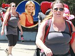 Battling the baby weight: Baywatch star Nicole Eggert gets stuck into some exercise with her ten-month-old in tow