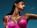 Real or fake? Brazilian model Isabeli Fontana sports a deep tan as she models H&M's new swimwear collection - but the store has attracted criticism for promoting unhealthy tanning habits
