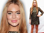 Face it Lindsay, that's not a good look: Lohan appears older than her years with puffy pillow face, big brows and blotchy fake tan