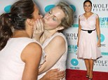 Are you trying to tell us something? Law and Order star Mariska Hargitay and comic author Ali Wentworth kiss passionately on red carpet