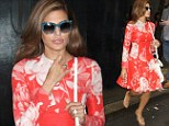 Eva so lovely! Mendes channels Sixties style and bares her endless legs in bold floral coat