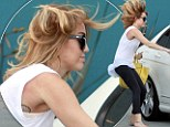 Hair-raising antics from super-toned Miley Cyrus as runs barefoot from her Pilates class