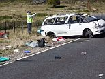 Tragedy: Policemen examine the scene of a minivan crash near Turangi, New Zealand. Three Boston University students who were studying in New Zealand were killed