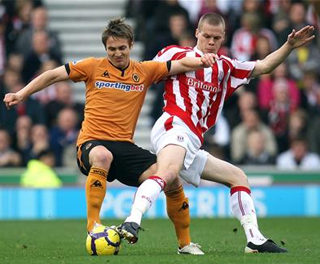 Ryan Shawcross battles for the ball with Wolves' Kevin Doyle. ACTION IMAGES