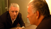 Derek Acorah through mirror