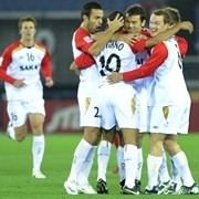 Australia's Adelaide United forward Cristiano (C, 10#) is congratulated by teammates
