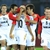 Australia's Adelaide United forward Cristiano (C, 10#) is congratulated by teammates after connectin