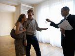 Male estate agent handing house keys