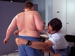 Overweight boy being measured at Carnegie Weight Loss Centre for fat and overweight children Leeds United Kingdom