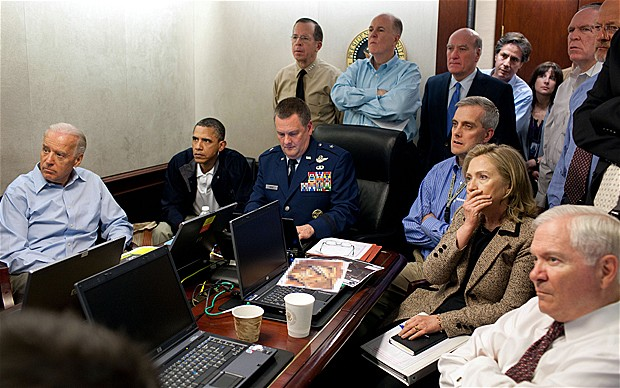 President Barack Obama, Vice President Joe Biden and Secretary of State Hilary Clinton, along with with members of the national security team, receive an update on the mission against Osama bin Laden in the Situation Room of the White House