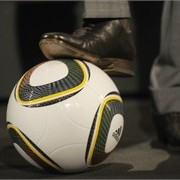 The shoe of England international David Beckham rests on 'Jabulani' the official match ball of the 2010 FIFA World Cup.